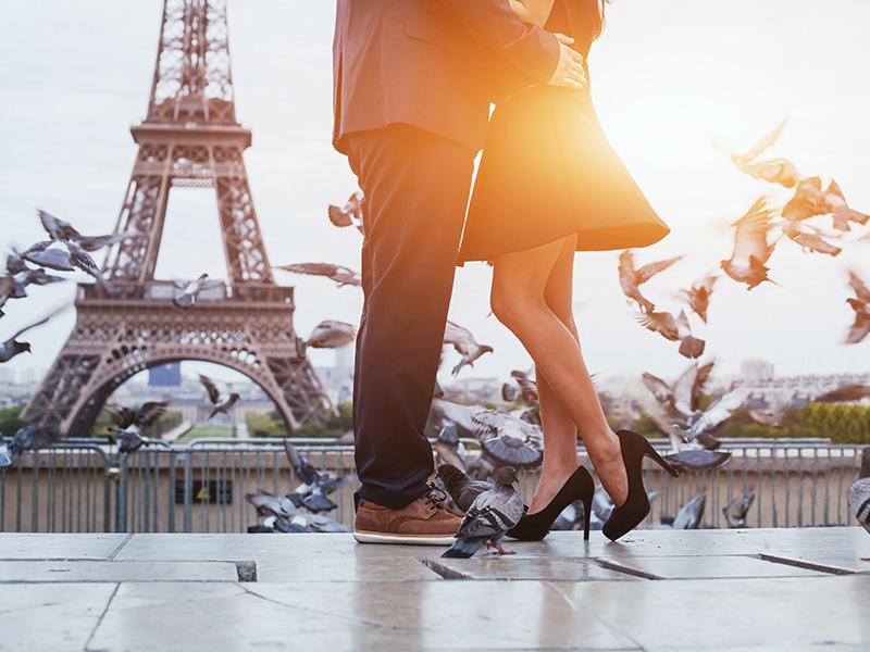 Couple Kissing In Paris, France